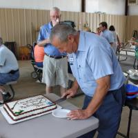 Congratulations on your retirement Tom cutting cake
